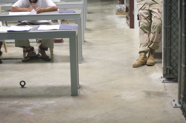 A detainee reading documents during a class in Camp 6 at the Guantánamo Bay Detention Facility in Guantánamo Bay, Cuba.