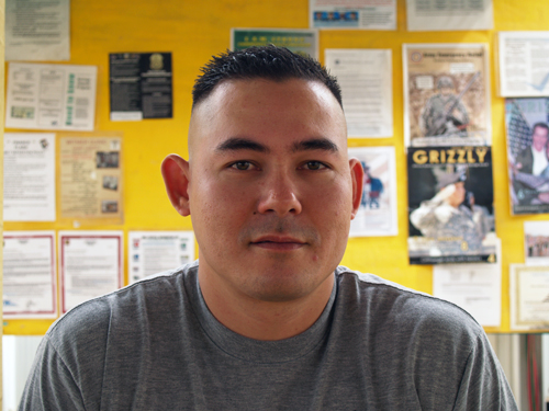 A Vietnamese American man with a crewcut.