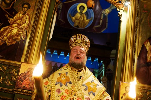 Alexius, Archbishop of Tiberias, leads a singing celebration of the resurrection of Jesus Christ in the courtyard of the Church of Saint Porphyrius in Gaza. Alexius has lived and ministered in the Holy Lands for the Greek Orthodox Patriarchate for more than thirty years, and has presided over Gaza's congregation since 2001.