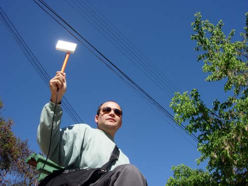 Man Holds Antenna