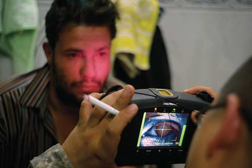 American soldiers take a biometric scan of Ziad.