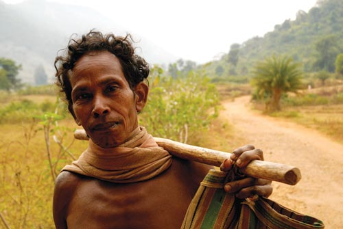 Bare-chested Man Carrying Stick
