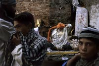 Lahore: In the back alleys of the old city, people gather around an elder for advice and conversation.