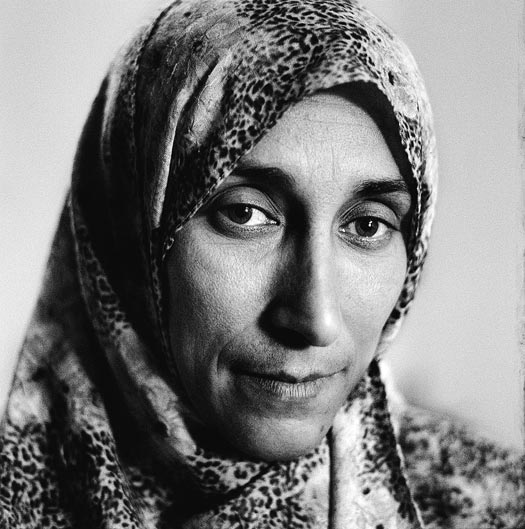 A woman with a long face and a headscarf.