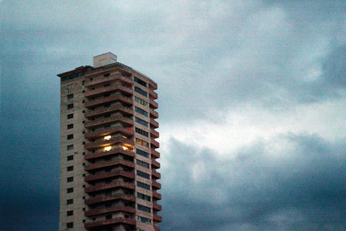 Apartment Building Against the Cloudy Sky