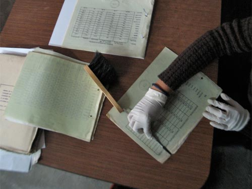 Worker cleaning and preserving a document