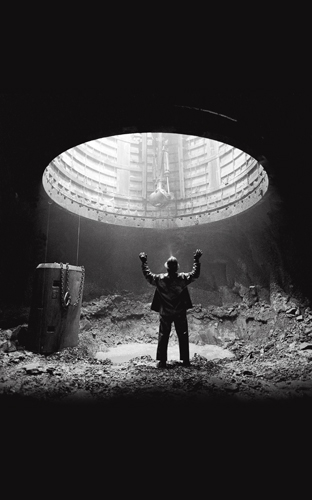 Shaft miner at the 2,500-foot-level station before mucking and drilling, Louvicourt Mine, Val-d'Or, Quebec.