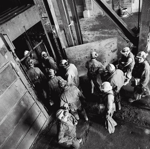Miners entering the cage for the beginning of day shift at Kerr Mine No. 3 Shaft.