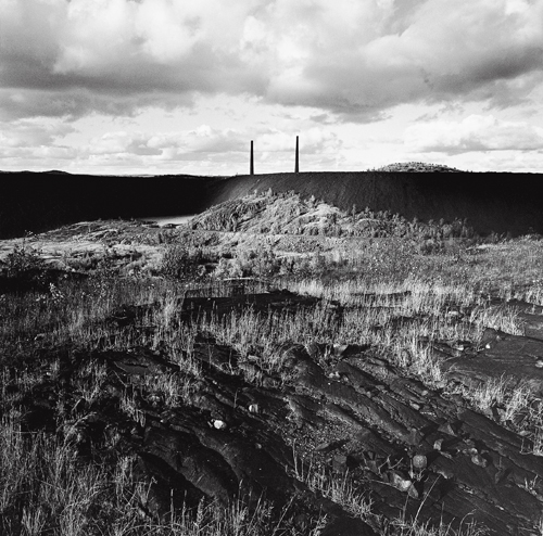 Slag heaps, smoke stacks, and rock blackened by decades of emissions from the Coniston Smelter, Coniston, Ontario.