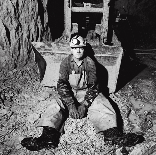 Steve Allen sitting in front of a Cavo 320 mucking machine at the 1,450-foot level of the Kerr Mine.