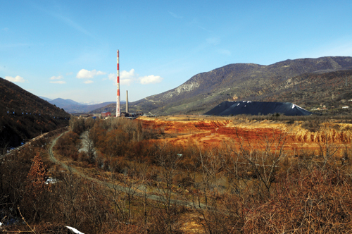 The Trepča mining and smelting complex, and its enormous slagheap, near the Osterrode Chesmin Lug resettlement camps for displaced Roma, North Mitrovica, Kosovo.