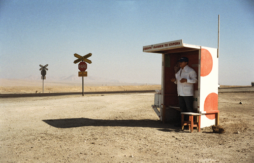 Ice cream seller Pablo Montero appears like a mirage in the desert, scooping up cones of vanilla and coffee ice cream for passing truckers and miners.