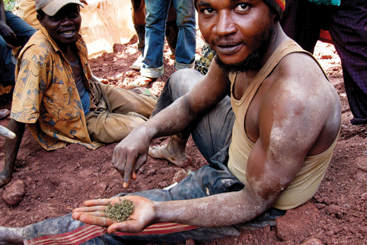 A miner shows a handful of the hash favored by the pit and tunnel miners at Bisie.