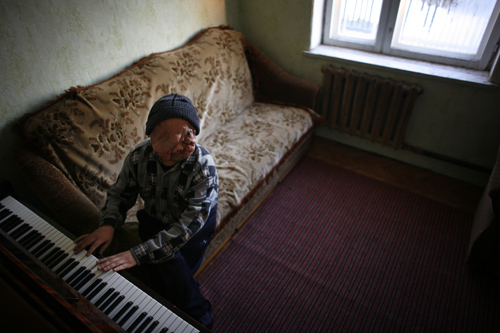 Berik Syzdykov, twenty-nine, sings and plays piano in Semey.
