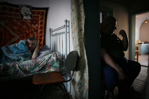 Brothers Anatoly, left, and Alexander Shakhvorostov sit in their house in Dolon, Kazakhstan, on the outskirts of the Nuclear Polygon.
