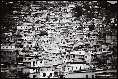 In the last century, the city of Caracas has grown from three hundred thousand residents to more than six million—many of whom now live in dangerously unstable and crime-riddled barrios on the surrounding mountainsides.