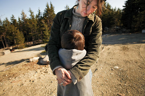 Jennifer Eaton Larrabee, outside, hugging her son, Jacob.