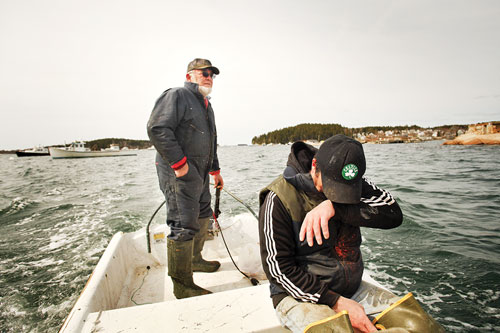 Captain Dick Bridges aboard his skiff after hauling traps with sternman Tom Hardy.