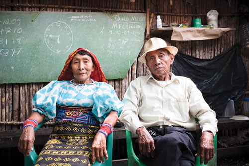 Leodomiro and Imelda Paredes seated in their home in Usdup.