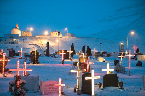 In Iceland's Westfjords region during the holidays, local cemeteries, like this one in Bolungarvík, are decorated with lights and illuminated crosses to commemorate the many, many local fishermen who have lost their lives at sea.
