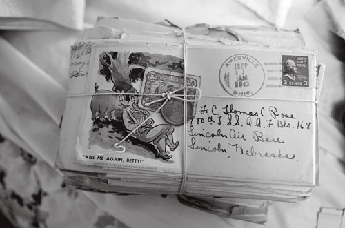 Correspondence between Tom and his wife Mary from WWII sits tied together in an upstairs bedroom.