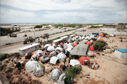 IDP camps, like this one near the airport in Mogadishu, have sprung up all over Somalia's capital city. The lack of aid available to them there has sparked a mass exodus of hundreds of thousands across the border into Kenya. Photo by Jason Florio