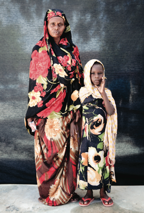 Isha Mohammad Adan, forty-eight, and her daughter Fartun Hassan Ibrahim, five, fled to Mogadishu when al Shabaab took over their village—seizing houses and farmsteads, raping women and stealing livestock. In three weeks since arriving in the refugee camp in Boondheere district of Mogadishu, they had received no aid from the government. Photo by Jason Florio)