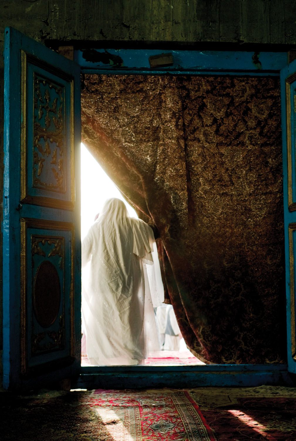 A Sufi shrine at a mosque frequented by Hazara, often the target of Daesh and Taliban attacks. Kabul, Afghanistan. 2010. Photo by Monika Bulaj.