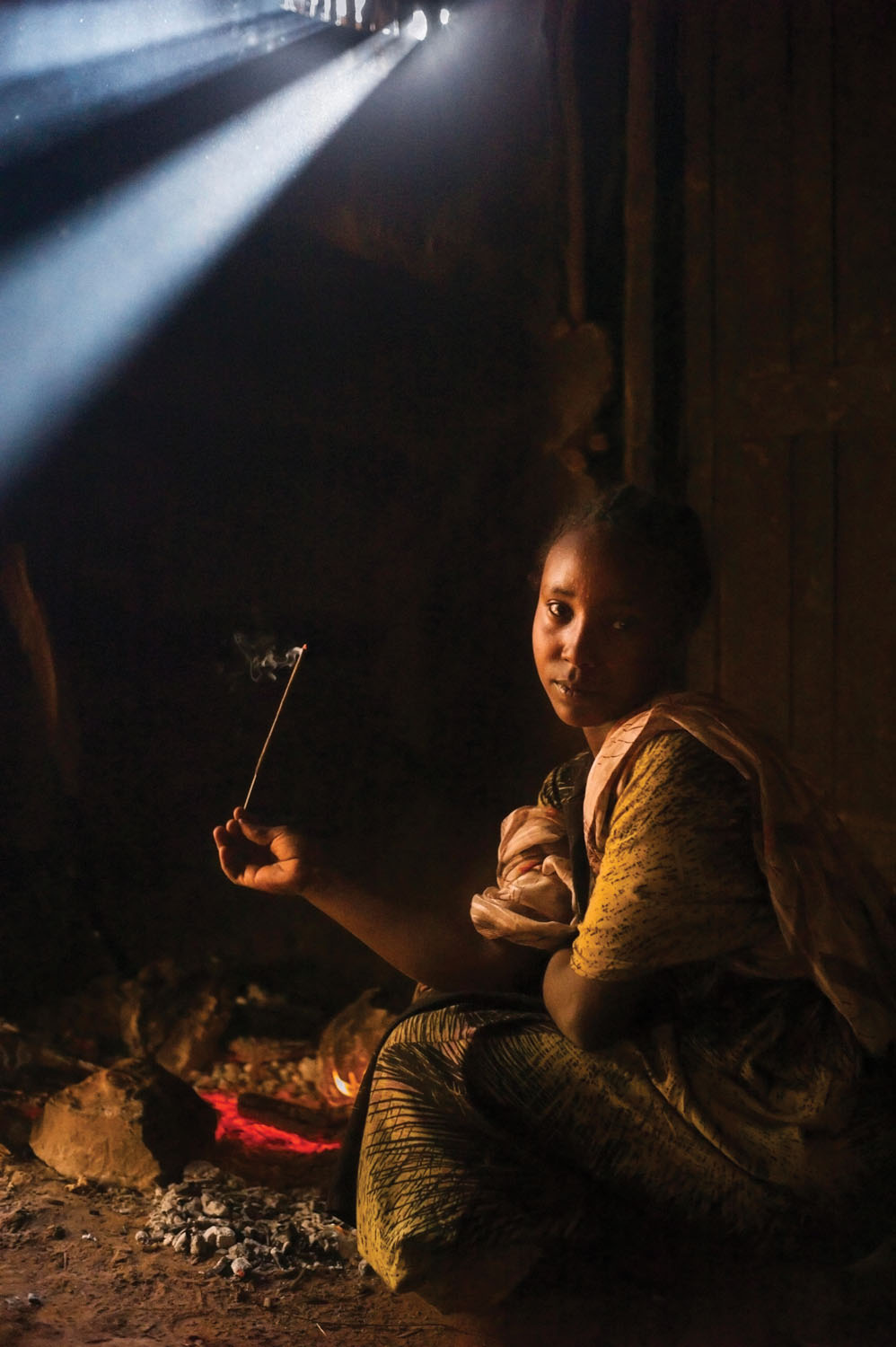 An Oromo woman with incense at a Sufi shrine. Ethiopia. 2014. Photo by Monika Bulaj.