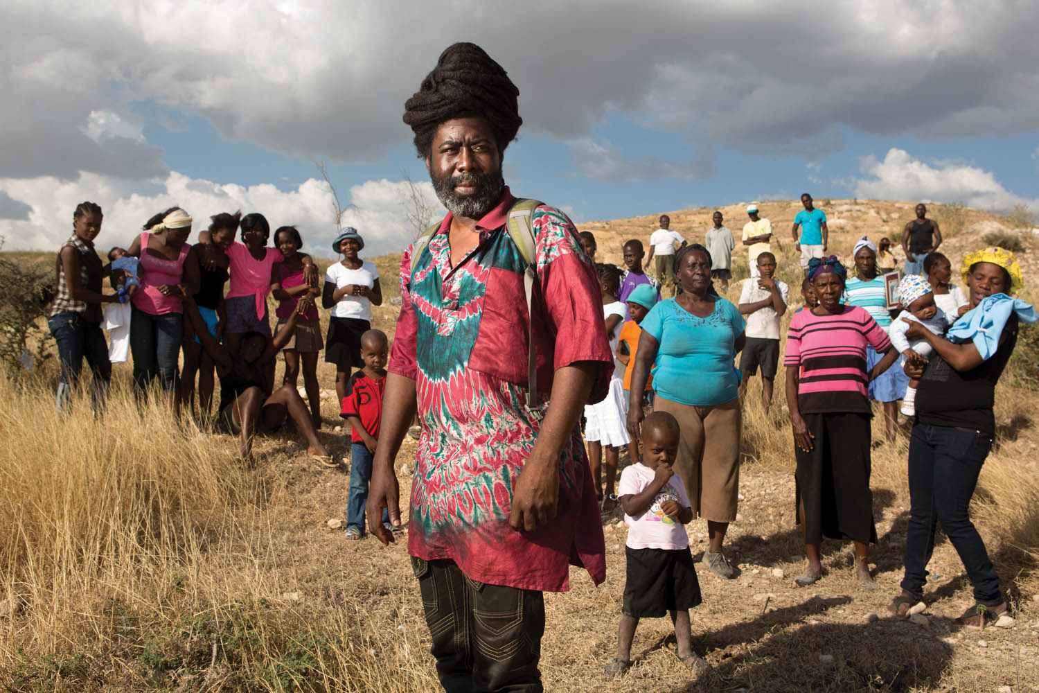 Mona Augustin at the site in Canaan where, in 2012, 126 families bought land rights in order to establish a camp they called Mozayik. Later, a competing, more powerful claimant forced them to move. Photo by Allison Shelley