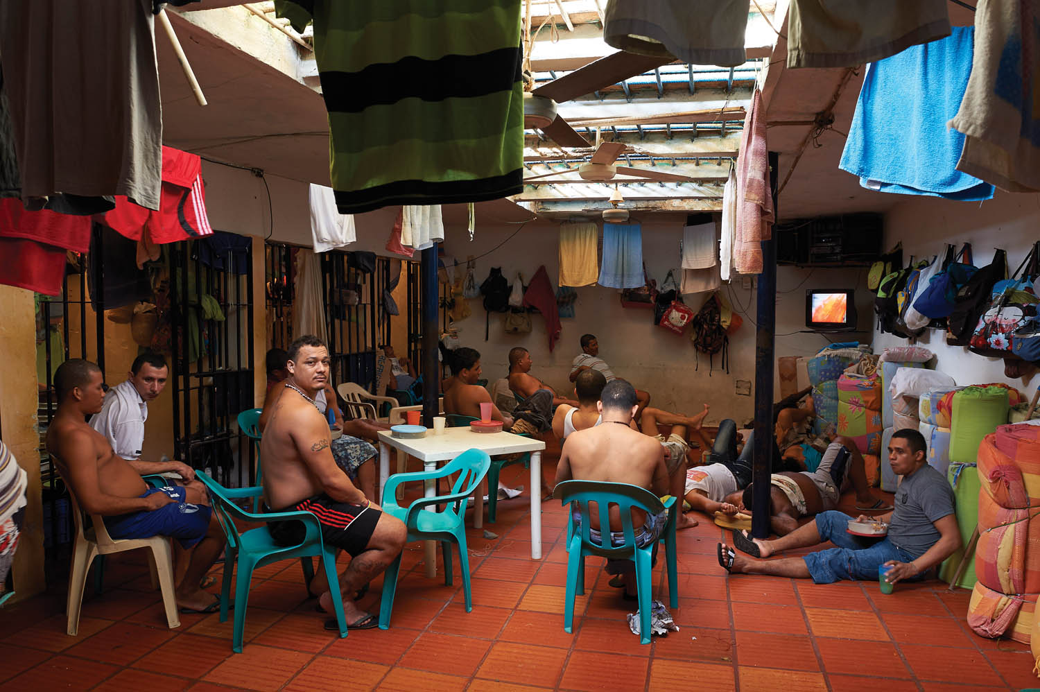 Establecimiento Carcelario de ReclusiÓn Especial, a medium-security prison with an o cial capacity of  fty inmates. It houses more than 100, and many sleep on the  oor. Sabanalarga, Colombia, 2011. Photograph by Jan Banning.