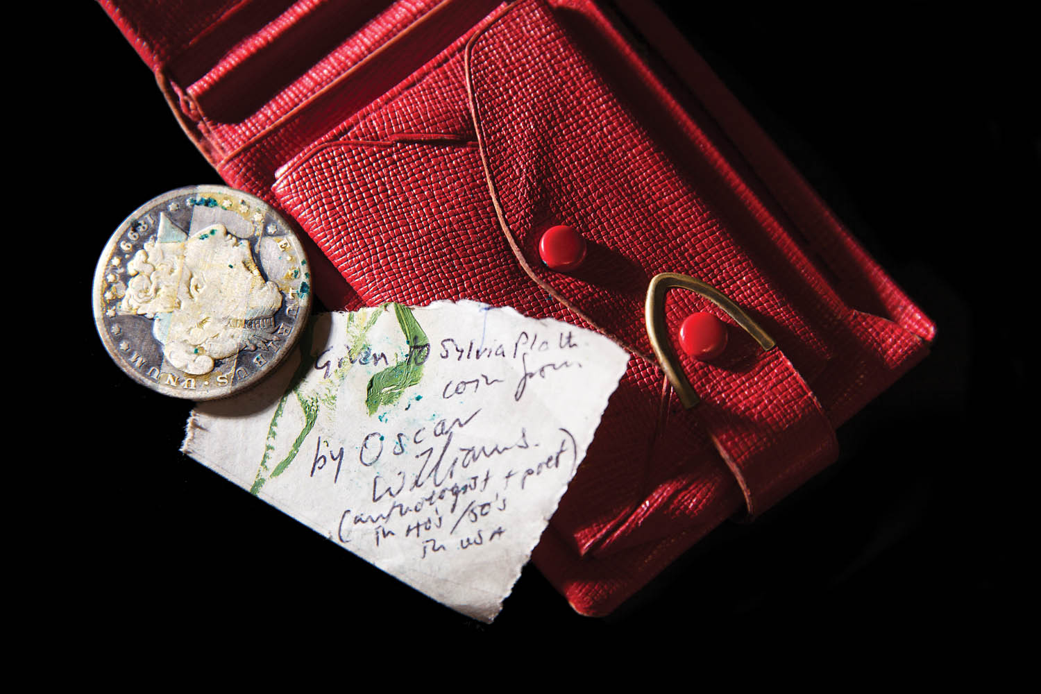 Sylvia Plath's red wallet with American Liberty silver dollar from poet friend Oscar Williams in coin purse. Photographed by Jo Emmerson