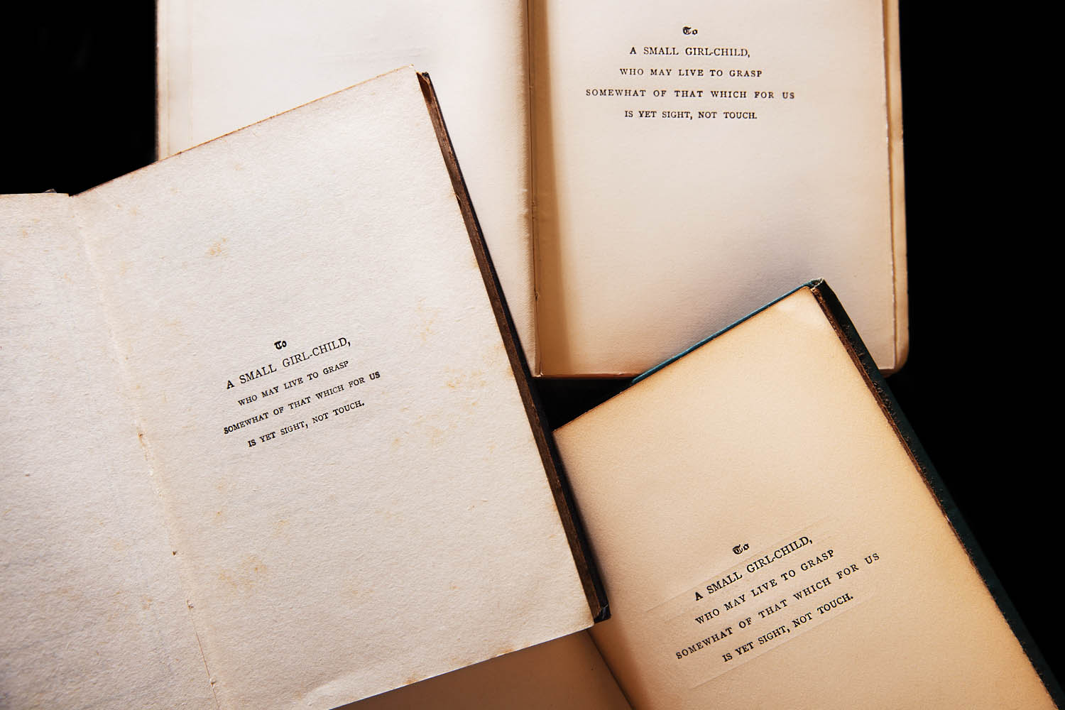 Three different editions of Olive Schreiner's novel Dreams. Photographed by Jo Emmerson