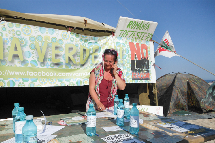 In the seaside village of Vama Veche, Romania, Rodica Cruceanu collects signatures to push for a parliamentary commission to investigate the environmental impact of fracking.