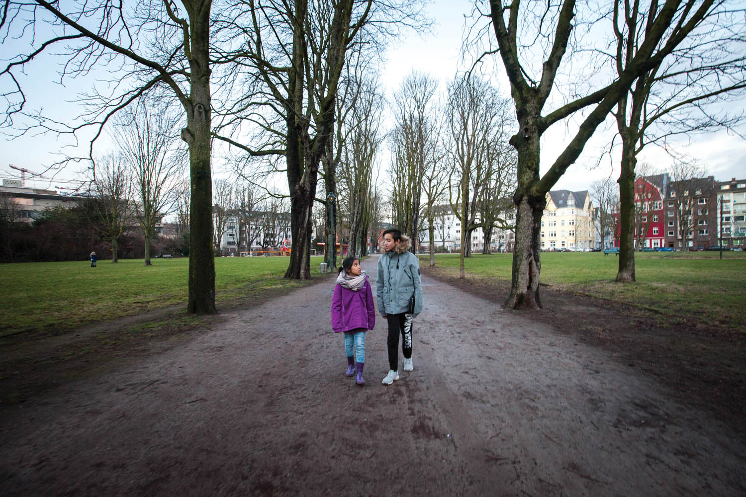 Milad (right) with his sister Mahya at the Frankenplatz park near their shelter in Düsseldorf. January, 2017. Photo by Diàna Markosian.