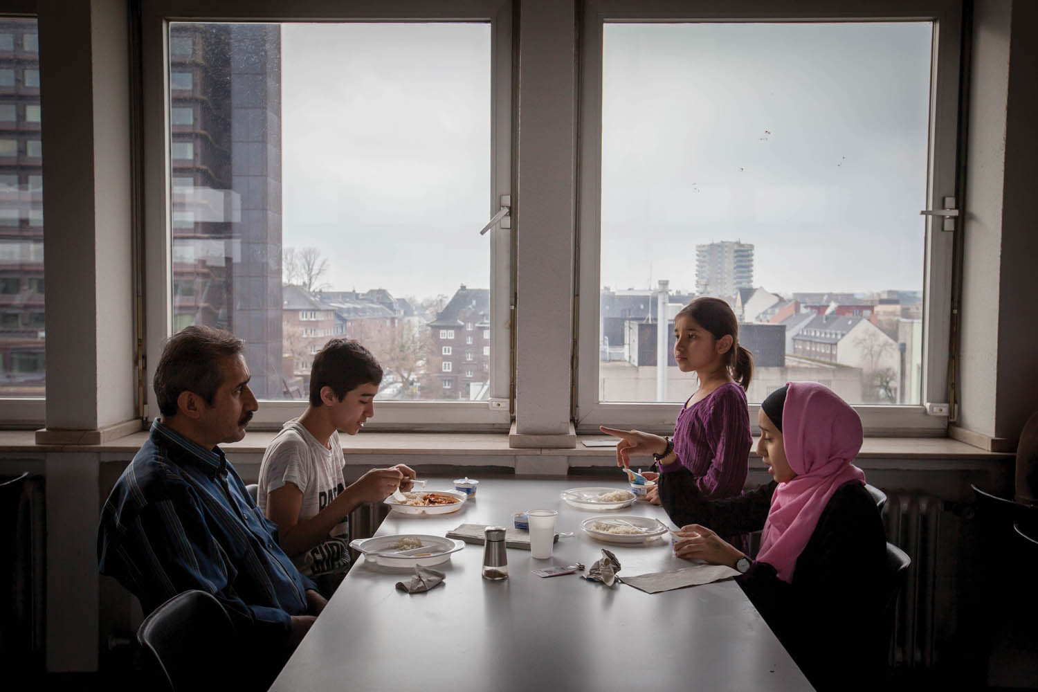 "At the shelter, residents do not have individual kitchens. They must all eat at the cafeteria on the fourth floor.  ""Every day my family goes upstairs to get food and wait in line,"" Milad said. ""When we ask for more, they say we can't have any. I don't know why."" Photo by Diàna Markosian."