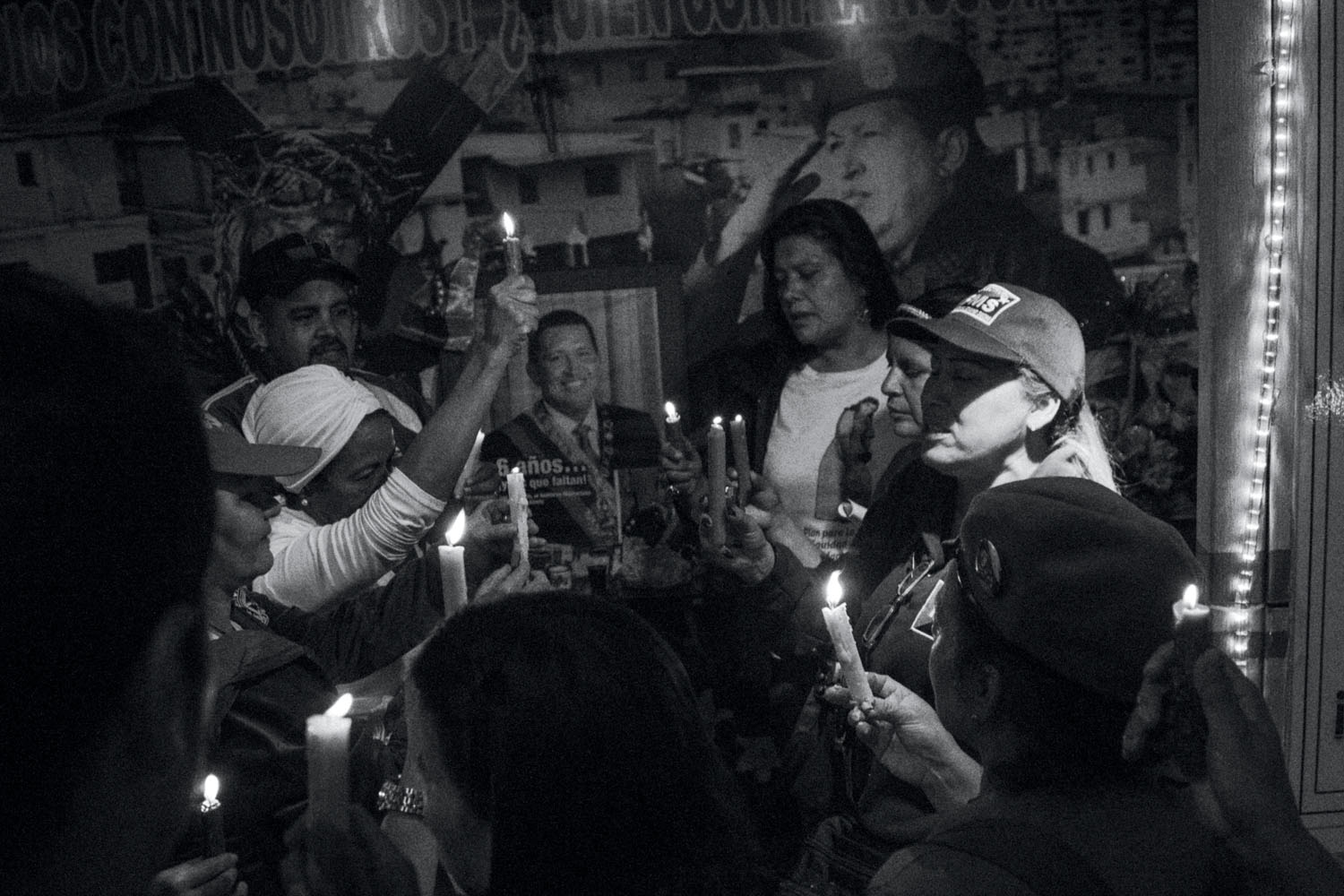 Photograph by Fabiola Ferrero. Supporters of the late President Hugo Chávez praying on the first anniversary of his death, in 2014, in a small chapel, named Santo Hugo Chávez, dedicated in his honor.