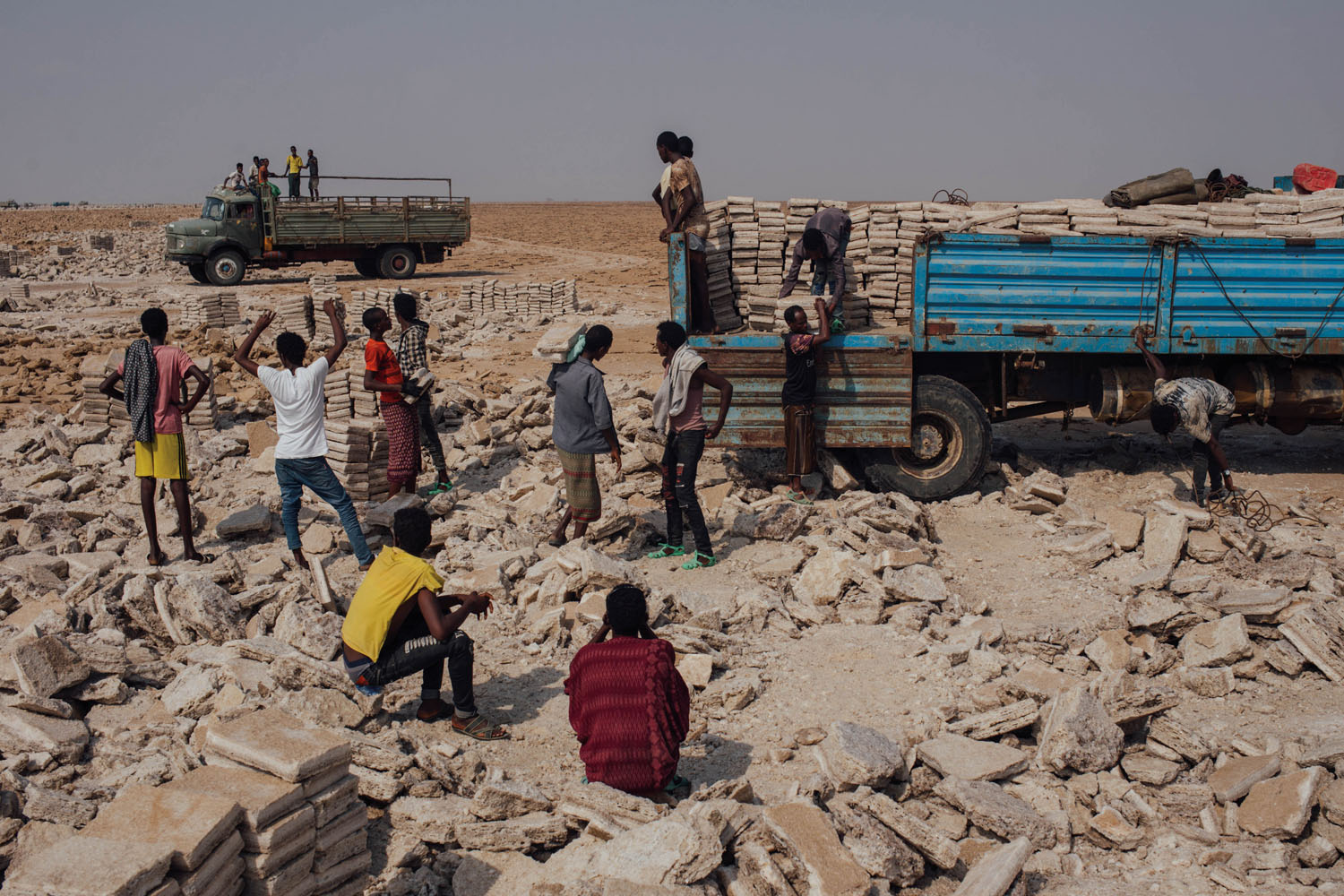 Miners load a truck with salt bricks to be transported to the nearest trading village. In the harsh conditions of the Danakil Depression, salt mining is one of the only sources of income outside the tourism industry. Photograph by Alex Pritz.