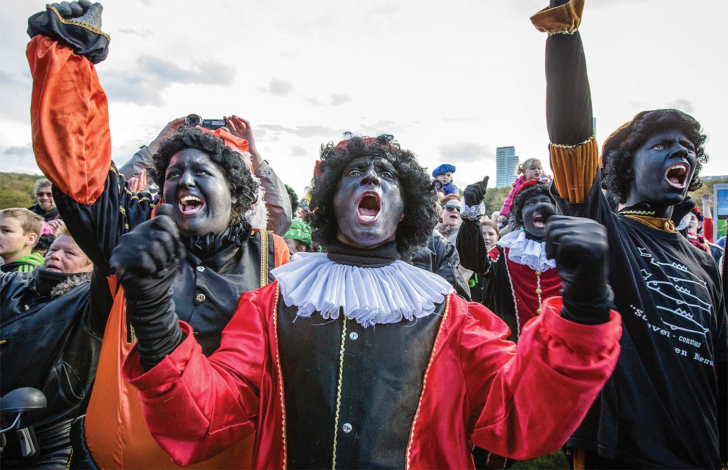 On October 26, 2013, several hundred people demonstrated at the Malieveld in The Hague to keep Zwarte Piet as part of the traditional Dutch Sinterklaas  celebration. The demonstration was an outgrowth  of a Facebook page dedicated to saving Zwarte Piet. (Bart Maat / Hollandse Hoogte / Redux)