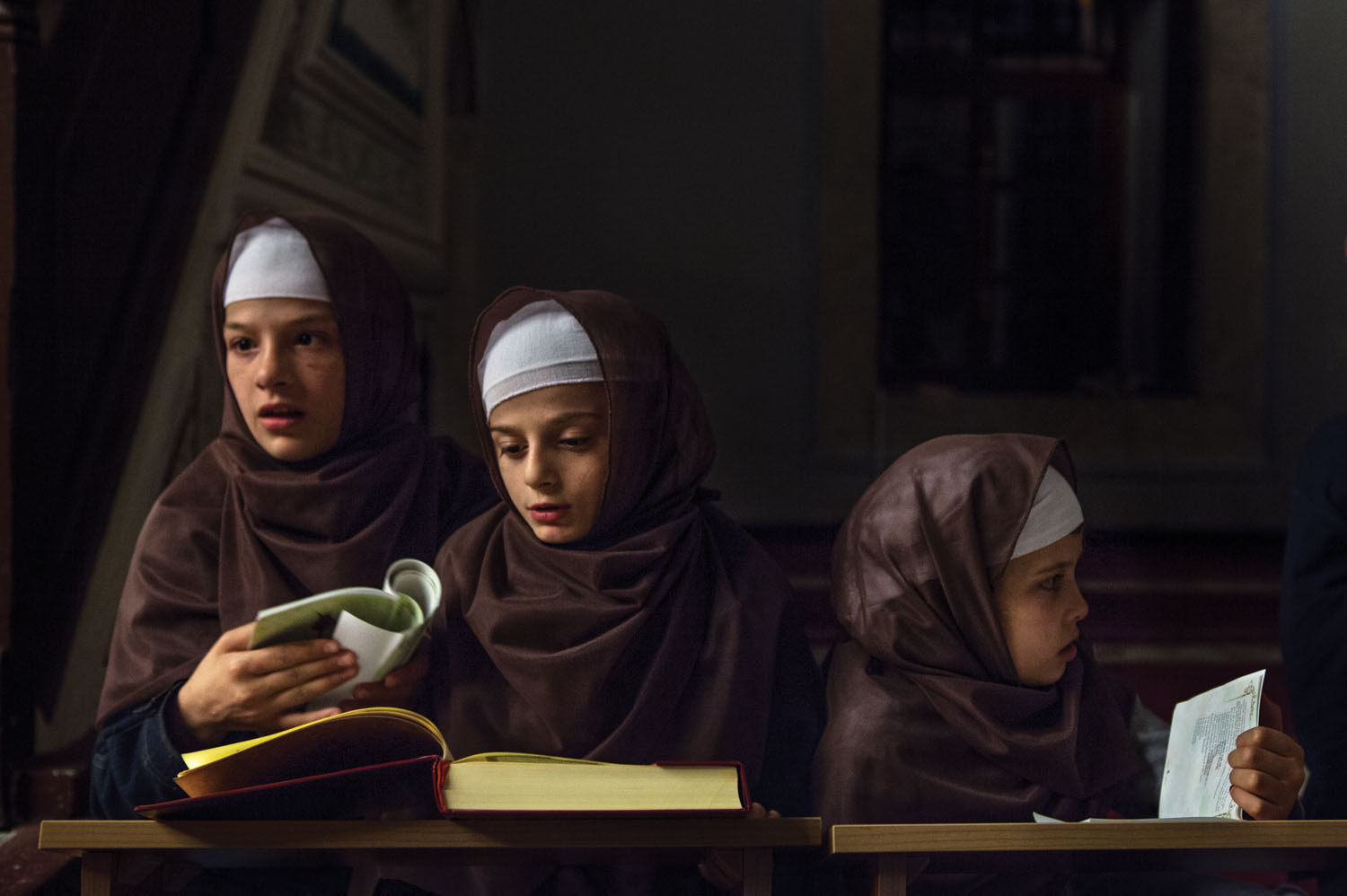 Albanian children studying the Koran. Kosovo. 2013.