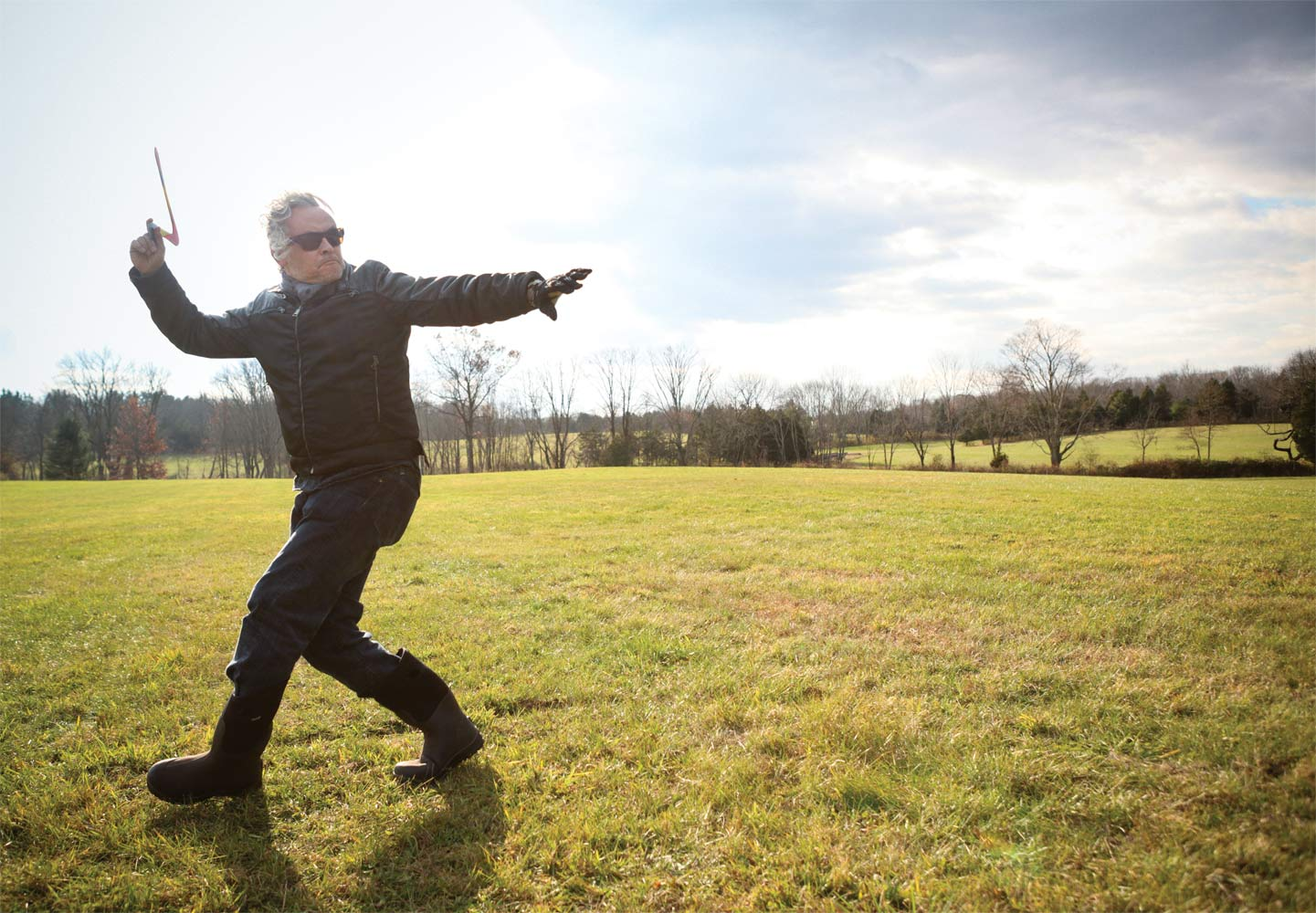 Orozco throwing boomerangs at his Pennsylvania farm, 2013. (Oskar Landi)