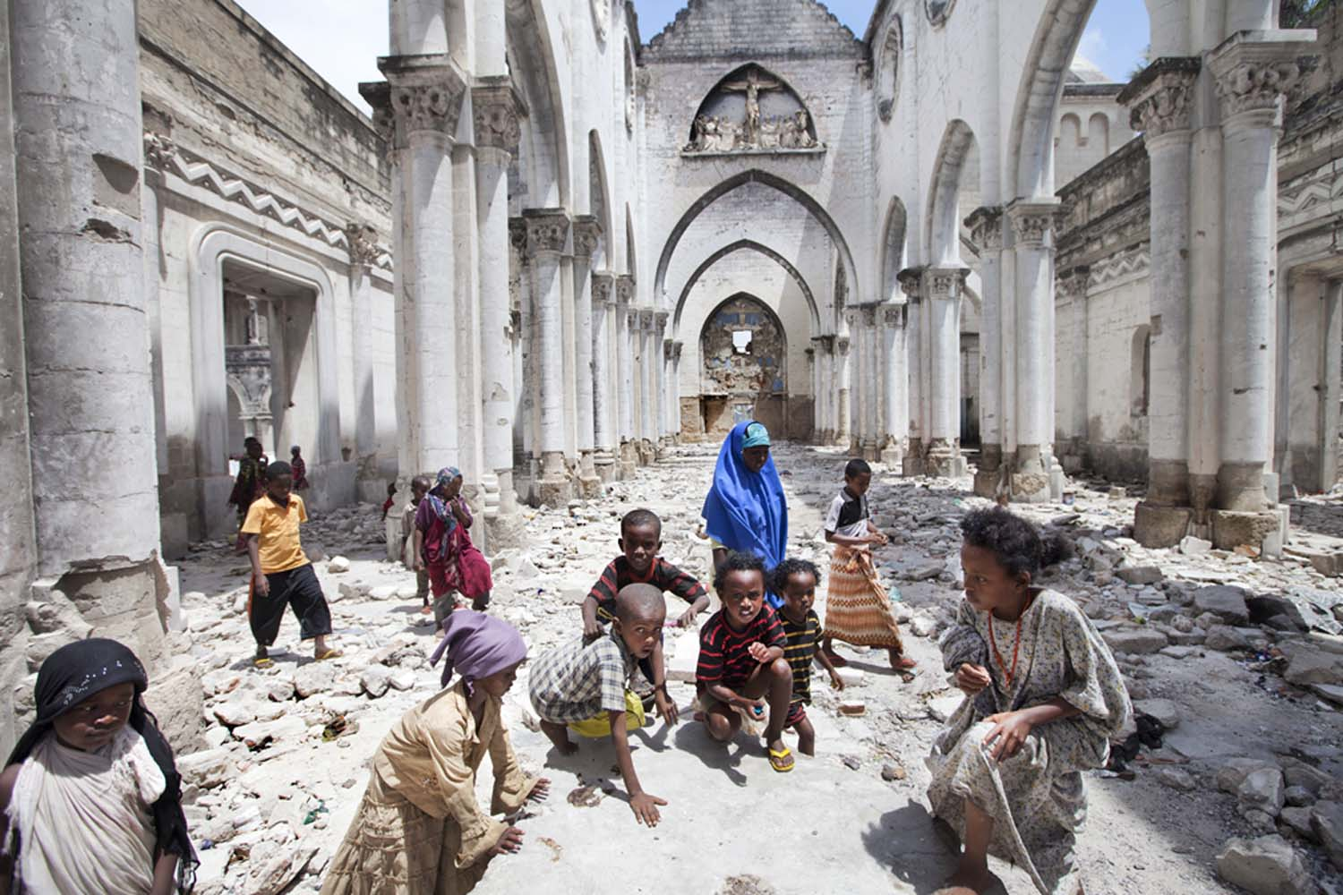 Children from Al-Adala, a nearby IDP camp, play in Mogadishu Catholic Cathedral, destroyed by Islamists in 2008