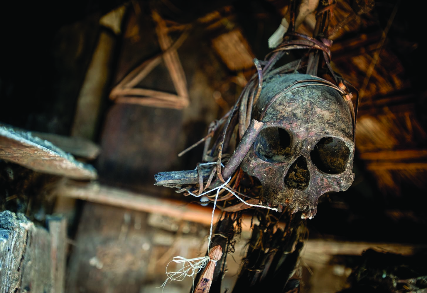 Legend has it that the skull hanging in the hut behind the chief of Pansar's house once belonged to a Koki warrior. Despite its unimpressive setting, the chief said that the skull still has the power to cause trouble for anyone who disrespects it. Photo by Elliott D. Woods.
