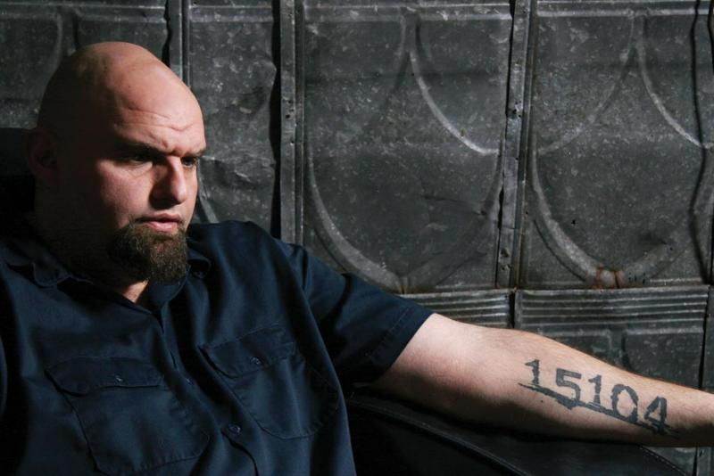 Mayor John Fetterman, his arm tattooed with Braddock's zip code.
