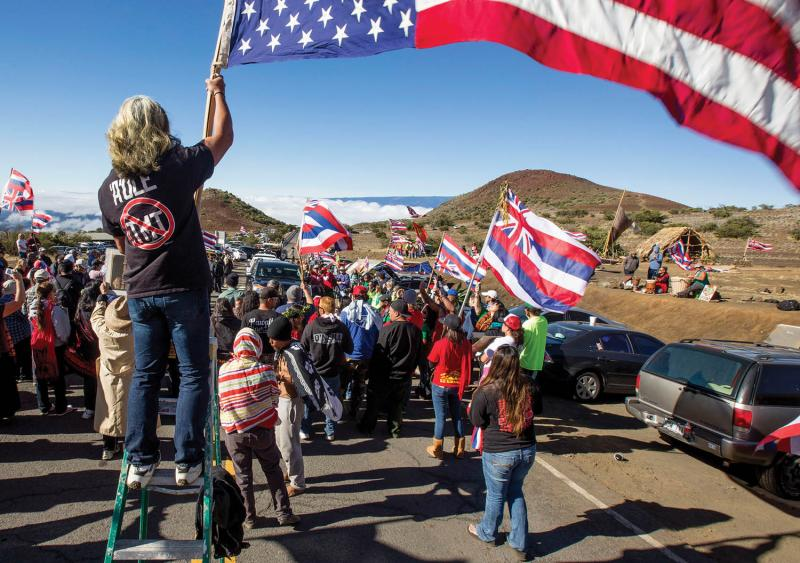 Protesters during the first of many blockades to stop construction of the Thirty Meter Telescope, June 2015. (Holly Johnson/Hawaii Tribune-Herald/AP)