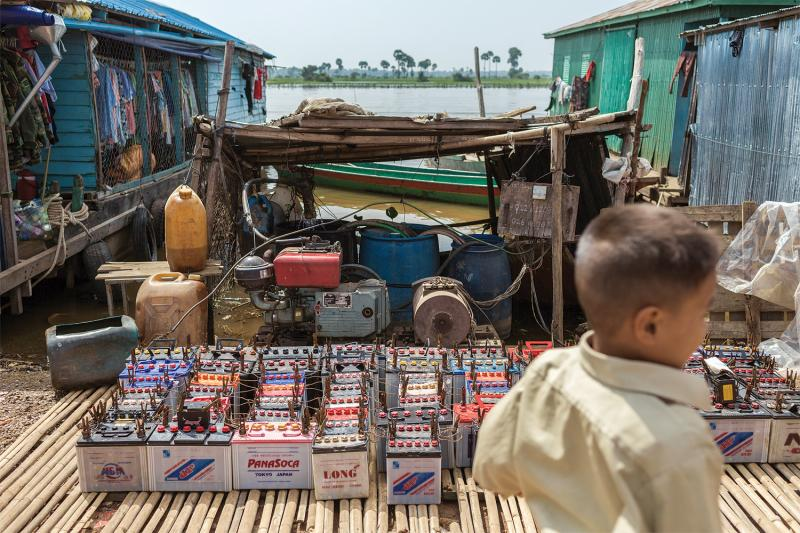 Car and truck batteries—a primary source of power for the majority of households in rural Cambodia—are recharged by a community  generator. (Thomas Cristofoletti/Ruom)