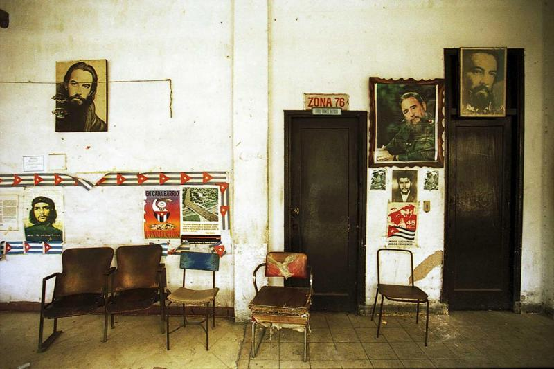 An office in Havana Vieja with the images of  revolutionaries, Fidel Castro, Ché Guevara and Camilo Cienfuegos.
