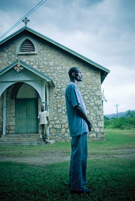 Glendon Asphall stands in front of a church near Portmore.