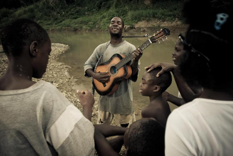 Lascelles sings church hymns by the river in Spanish Town.