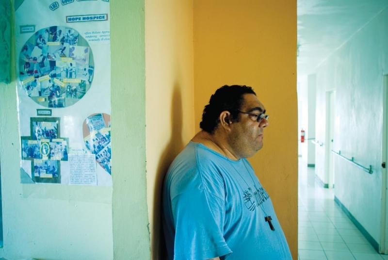 John Marzouca stands in the hallway of Hope Hospice, outside Montego Bay.